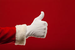 Photo of Santa Claus gloved hand in pointing Royalty Free Stock Photo