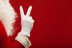 Photo of Santa Claus gloved hand in pointing Stock Photo