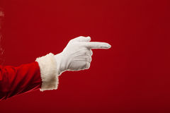Photo of Santa Claus gloved hand in pointing Stock Photos