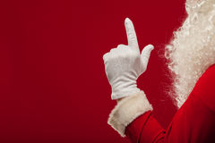 Photo of Santa Claus gloved hand in pointing gesture. fingers Stock Images