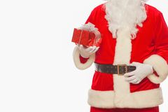 Photo of Santa Claus gloved hands holding red giftbox, isolated. On white background Christmas stock images