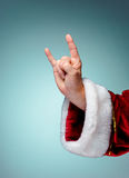 Photo of Santa Claus hand in rocker gesture royalty free stock photo