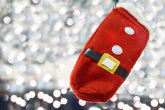 Photo of santa claus red glove. Over background with light bokeh dots, shallow depth of field Royalty Free Stock Images