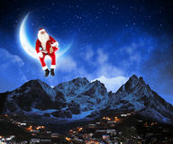 Photo of santa claus sitting on the moon Stock Image