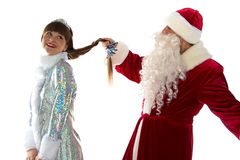 Photo of Santa holding a maiden's braid Royalty Free Stock Images