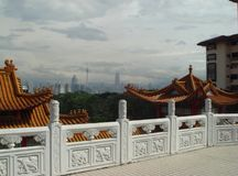 Photo scenery with vague prospects of the modern capital of Malaysia. Site of the sacred religious building of the Temple of the serpent or Temple of the azure Royalty Free Stock Photography