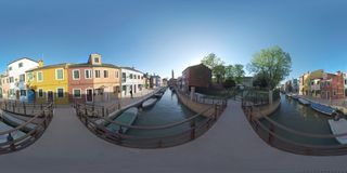 360 VR Burano picturesque townscape with canal, church and colored houses, Italy. 360 photo - Scenic townscape of Burano island in Italy. Rows of painted homes royalty free stock photography