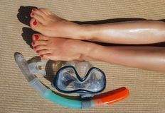 Photo of scuba, female legs on mat on summer royalty free stock image