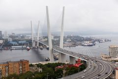 Photo of sea bay with buildings, ships, bridge. In summer Stock Photo