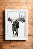 Photo of seniors in picture frame laid on wooden background. Stock Photography