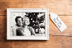 Photo of seniors in picture frame laid on wooden background. Stock Images