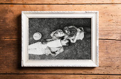 Photo of seniors in picture frame laid on wooden background. Stock Photo