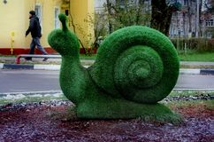 Shchyolkovo. Sculpture of a snail made of artificial grass. Royalty Free Stock Photo