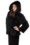Photo of serious woman in fur coat with hood Royalty Free Stock Image