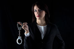 Photo serious woman with pair of handcuffs Stock Images