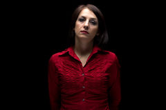 Photo of serious woman in red shirt Royalty Free Stock Image