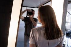 Photo session backstage. Photographer shoot model royalty free stock photo