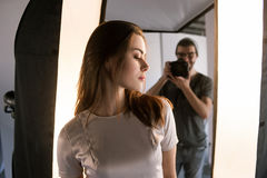 Photo session backstage. Photographer shoot woman Stock Images