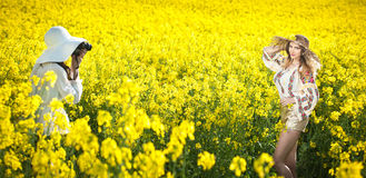 Photo session in canola field with beautiful Romanian girl Stock Photography