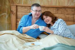 Morning tea. Husband brought his wife tea coffee to the bed stock image