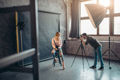 Photo session lasting several days for press. Full length photo royalty free stock image