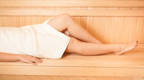 Photo of sexy slim women legs at sauna Royalty Free Stock Image