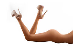 Photo of a sexy woman lying over white background Stock Image