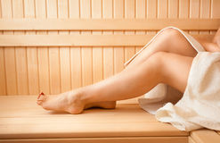 Photo of sexy women feet on bench at sauna Stock Photos