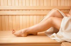 Photo of women feet on bench at sauna Stock Photos