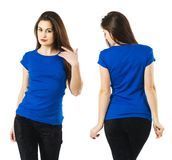 Sexy lady wearing blank blue shirt. Photo of a sexy young woman posing with a blank blue shirt, front and back Royalty Free Stock Image
