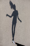 Photo of shadow of girl dancing at street Stock Photos
