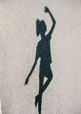Photo of shadow of woman dancing at street Royalty Free Stock Image