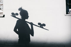Photo of shadows of girl with a skateboard Royalty Free Stock Images