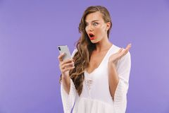 Photo of shocked european woman 20s with long curly hairstyle we stock photography