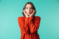 Shocked woman standing isolated. Photo of shocked woman standing isolated over blue background looking camera Stock Photos