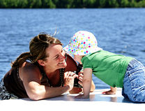 Photo Shoot. A photographer takes pictures of her one-year-old niece on the deck of a houseboat Stock Image