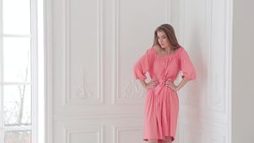 Photo shoot of beautiful romantic model in pink summer dress and stylist`s work stock video footage