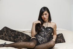 Beautiful sexy Asian women on a bed Royalty Free Stock Photo