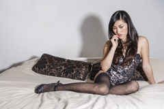 Beautiful Asian women on a bed royalty free stock photography