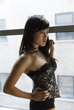 Beautiful sexy Asian women in front of a window Royalty Free Stock Images