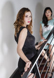 2 beautiful women on a stairway stock photography