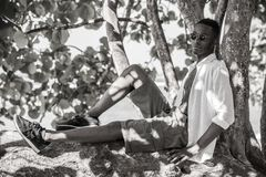 Black man on the tree in bw Royalty Free Stock Photos