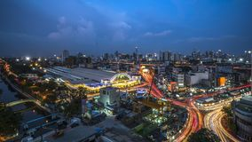 This photo shoot on the building. Bangkok public train station and Bangkok city at twilight time (With blur advertisement and long exposure photography creates royalty free stock photo