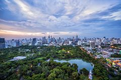 This photo shoot on the building. Lumpini Park and Bangkok city in sunset time.(With blur advertisement and long exposure photography creates motion of cloud Royalty Free Stock Photos