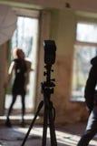 Photo shoot at model. Focus on flashlight royalty free stock photos