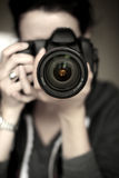 Photo Shoot. A woman takes a picture with a DSLR camera Stock Images