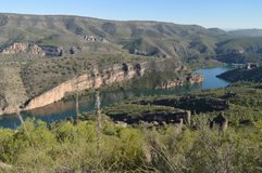 Photo Shooted From The High Of The Mountain Range Of Albalate Shows The Tajo River At Its Pass By Albalate De Zorita. Landscapes T. Ravel Holidays. October 29 royalty free stock photo