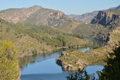 Photo Shooted From The High Of The Mountain Range Altomira Of Albalate Shows The Tajo River At Its Pass By Albalate De Zorita With. A Boat Crossing Said River stock photo