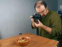 Photo shooting food. Photographer working in the studio stock image
