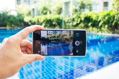 Photo shooting on smartphone at swimming pool Stock Photos